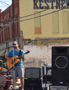 Blake Sherman, local singer and songwriter, entertains Art on Elm Avenue guests.